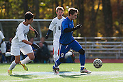Mount Anthony's Carter Bentley (9) runs down the field with the ball during the quarterfinal boys soccer game between Mount Anthony and Burlington at Buck Hard Field on Friday afternoon October 23, 2015 in Burlington. (BRIAN JENKINS/ for the FREE PRESS)