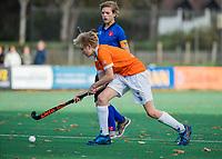 BLOEMENDAAL -  Tim Holz (Bldaal) tijdens de competitiewedstrijd hockey jongens B , Bloemendaal JB1-Breda JB1 (3-2)  , COPYRIGHT KOEN SUYK