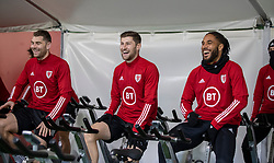 CARDIFF, WALES - Monday, November 18, 2019: Wales' Sam Vokes, Ben Davies and captain Ashley Williams on warm-up bikes during a training session at the Vale Resort ahead of the final UEFA Euro 2020 Qualifying Group E match against Hungary. (Pic by David Rawcliffe/Propaganda)