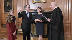 October 6, 2018 - Washington, DC, United States of America - Retired Justice Anthony Kennedy administers the oath of office to Judge Brett Kavanaugh in the Justices Conference Room of the U.S. Supreme Court Building October 6, 2018 in Washington, DC. Ashley Kavanaugh, center, holds the Bible as daughters, Margaret, and Liza, left, look on. (Credit Image: © Fred Schilling via ZUMA Wire)