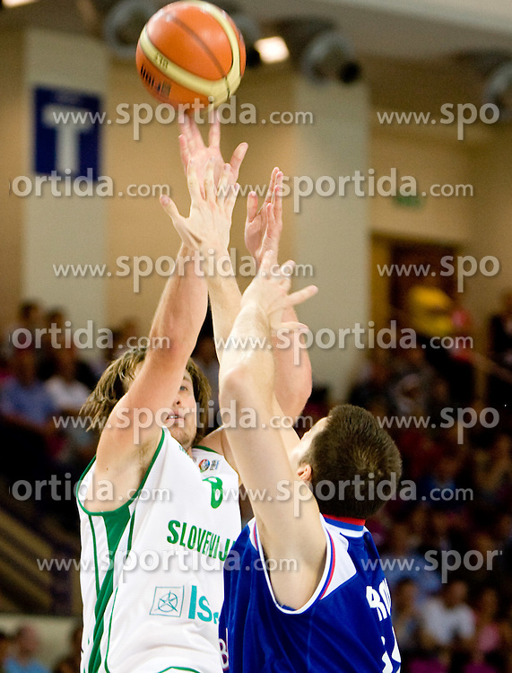 Matjaz Smodis (8) of Slovenia vs Kosta Perovic of Serbia during the basketball match at 1st Round of Eurobasket 2009 in Group C between Slovenia and Serbia, on September 08, 2009 in Arena Torwar, Warsaw, Poland. Slovenia won 84:76. (Photo by Vid Ponikvar / Sportida)