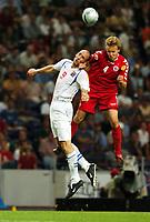 Jan Koller Czech Republic<br /> Martin Laursen Denmark<br /> Czech Republic V Denmark (3-0) 27/06/04 Quarter Finals  <br /> EURO 2004 PORTUGAL<br /> Photo Robin Parker Digitalsport