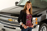 """ROYAL OAK, MICHIGAN - OCTOBER 12: Kathy Speck, former Senior Vice President, Associate Creative Director, Chevrolet Trucks at Campbell-Ewald, poses with a Chevy Silverado pickup truck in Royal Oak, MI, Wednesday, October 12, 2011. Speck and worked on and created the iconic campaigns """"From The Heartbeat of America,"""" to """"Like A Rock,"""" to """"Our Country/Our Truck.""""  (Jeffrey Sauger)"""