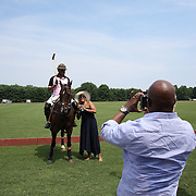 Spectators take photographs before the White Birch Vs K.I.G Polo match in the Butler Handicap Tournament match at the Greenwich Polo Club. White Birch won the game 11-8. Greenwich Polo Club,  Greenwich, Connecticut, USA. 12th July 2015. Photo Tim Clayton