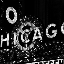 Chicago Theater sign in black and white at night in downtown Chicago, Illinois. The Chicago Theater is a Chicago Landmark and is listed with the National Register of Historic Places.