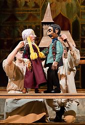 "© Licensed to London News Pictures. 20/03/2014. London, UK. Scene pictured: Eveline and Vadim with model church. Wilton's Music Hall presents ""Father Nandru and The Wolves"" by Julian Garner, a Romanian fantasy about a Transylvanian village performed with puppets that tell a gypsy tale about wolves and forests. Father Nandru and The Wolves is Wilton's last full scale production before the final stage of repair works begin to the main building at Wilton's, which is the oldest surviving grand music hall in the world.Photo credit : Vickie Flores/LNP"