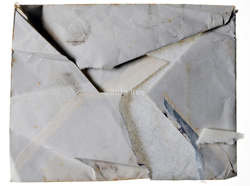 ripped open blank letter envelope