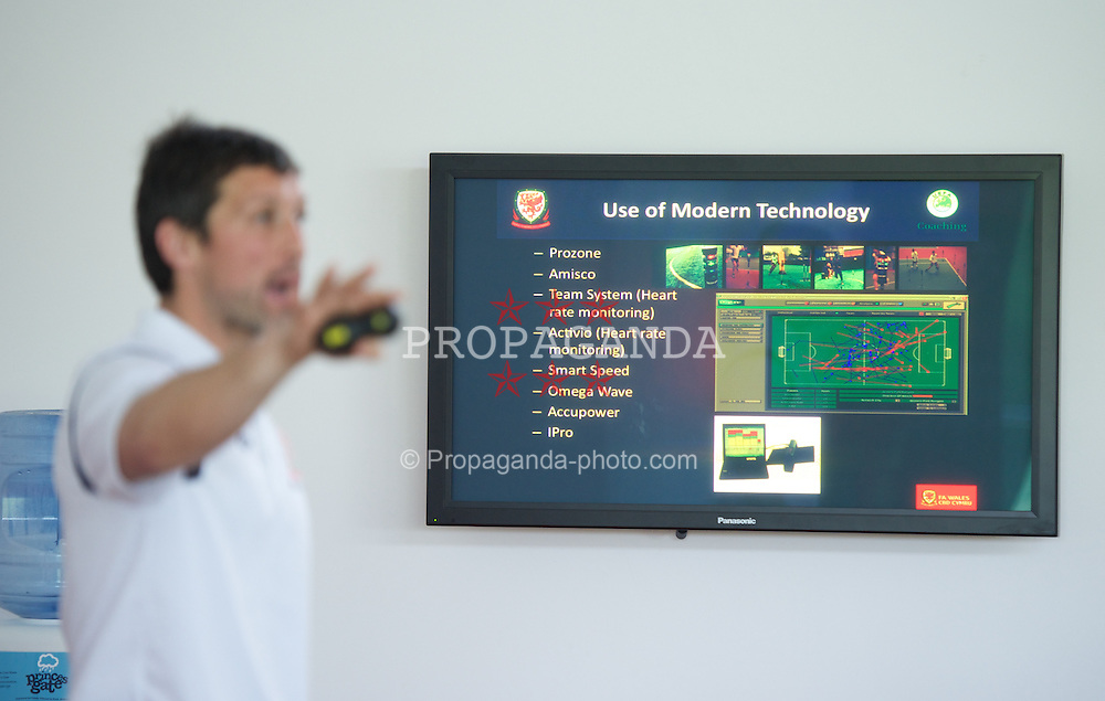 NEWPORT, WALES - Wednesday, May 22, 2013: Wales National Team's head of fitness and science Ryland Morgans gives a presentation during the Football Association of Wales' UEFA Pro Licence Course 2013 at Dragon Park. (Pic by David Rawcliffe/Propaganda)