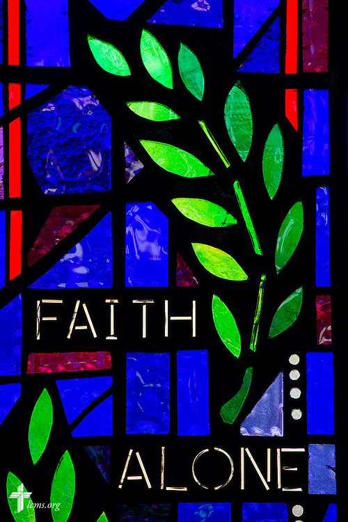 "Stained glass with the words ""Faith Alone"" on Sunday, Nov. 22, 2015, at Salem Lutheran Church in Springdale, Ark. LCMS Communications/Erik M. Lunsford"