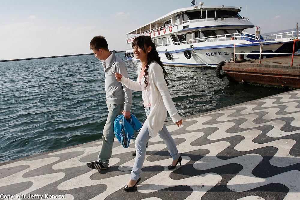 A couple walk along Kordon walkway in Izmir, Turkey