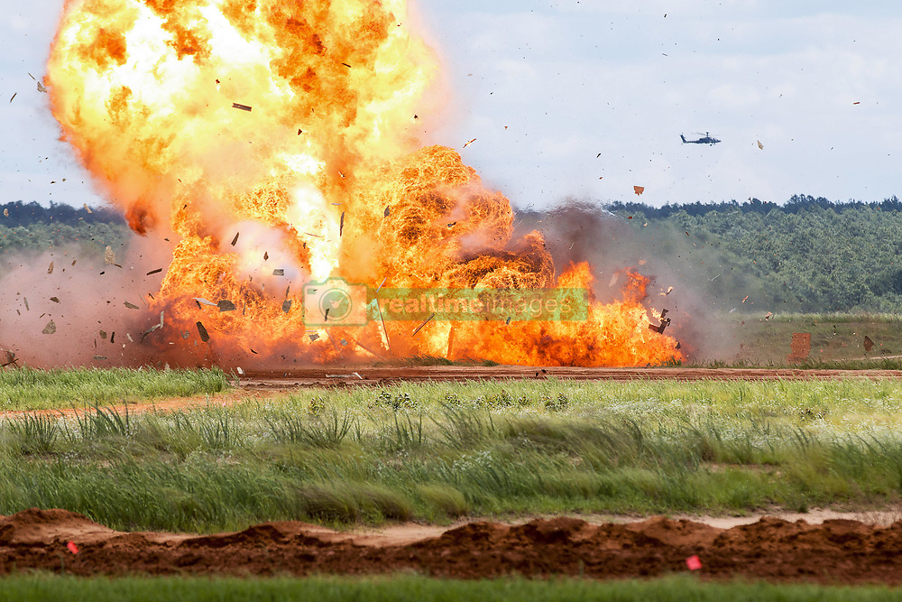 May 25, 2017 - Fort Bragg, North Carolina, U.S. - Paratroopers assigned to the 82nd Airborne Division detonate explosives during an airborne review at Fort Bragg, N.C., May 25, 2017. The review was the culminating event for All American Week, which celebrates the division. (Credit Image: ? Dustin D. Biven/DoD via ZUMA Wire/ZUMAPRESS.com)