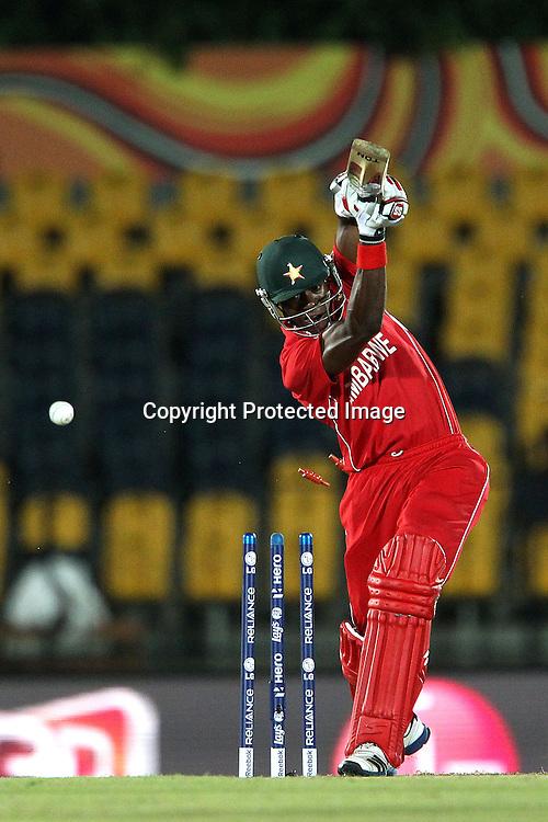 Vusi Sibanda is clean bowled by Morne Morkel during the ICC World Twenty20 Pool C match between South Africa and Zimbabwe held at the MAHINDA RAJAPAKSA INTERNATIONAL CRICKET STADIUM in Hambantota, Sri Lanka on the 20th September 2012<br /> <br /> Photo by Ron Gaunt/SPORTZPICS