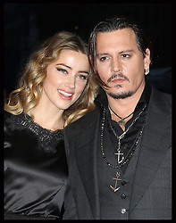 May 26, 2016 - File - AMBER HEARD has filed for divorce from JOHNNY DEPP after just 15 months of marriage amid claims his family hated her. The actress, 30, submitted court documents on Monday citing irreconcilable differences and seeking spousal support, triggering a battle over the star's 00 million fortune. Depp, 52, is father to 16-year-old Lily-Rose Depp and 14-year-old Jack Depp. His mom, Betty Sue Palmer, died just three days before Heard signed a petition for divorce Monday. Pictured: Oct. 11, 2015 - London, United Kingdom -  11/10/2015. London, United Kingdom. Johnny Depp and wife Amber Heard arriving at the Black Mass premiere on day five of the London Film Festival.  (Credit Image: © Stephen Lock/i-Images via ZUMA Wire)