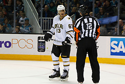 Mar 31, 2012; San Jose, CA, USA; Dallas Stars center Mike Ribeiro (63) argues a call with NHL referee Justin St. Pierre (12) during the second period against the San Jose Sharks at HP Pavilion. Mandatory Credit: Jason O. Watson-US PRESSWIRE
