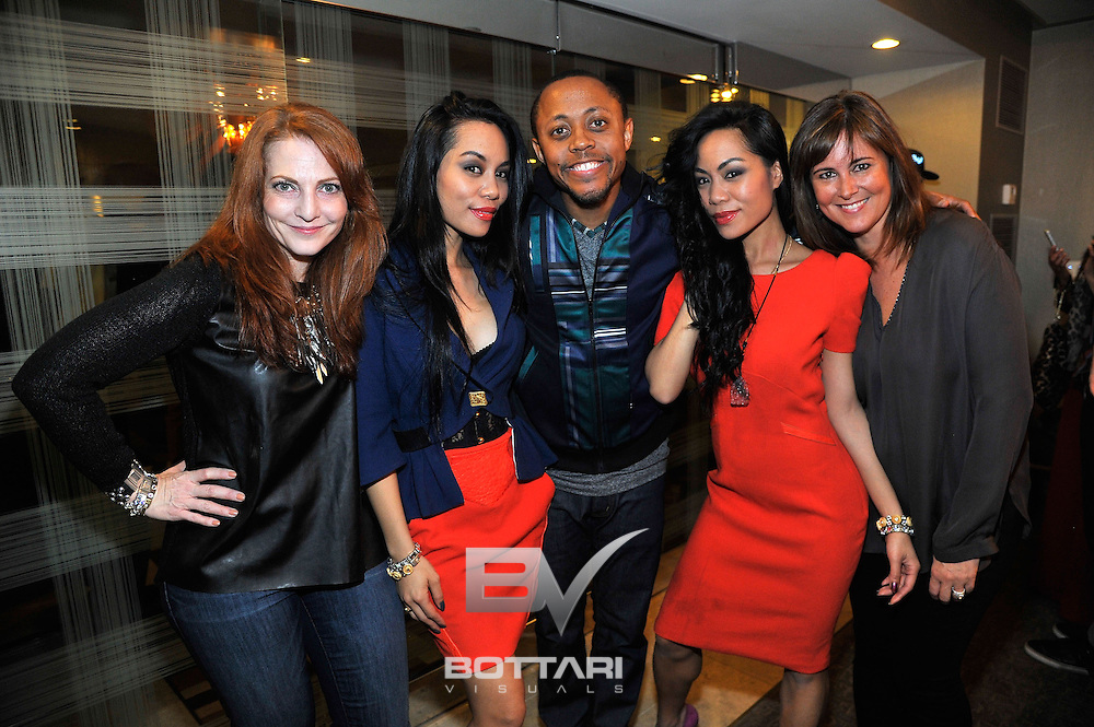 LAS VEGAS, NV - FEBRUARY 19:  (L-R) Designers Meri Devore, To-Tam Sachika, attorney Walter Mosley, designer To-Nya Sachika and Kim Strassner attend the FlauSachika Groups exclusive magic suite party at Aria Resort & Casino at CityCenter on February 19, 2013 in Las Vegas, Nevada.  (Photo by Jeff Bottari/WireImage)