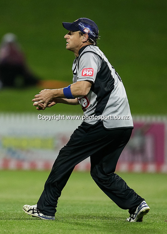 South Island's Nathan McCullum lines up a catch during the Island of Origin T20 cricket game - North v South, 31 October 2014 played at Seddon Park, Hamilton, New Zealand on Friday 31 October 2014.  Photo: Bruce Lim / www.photosport.co.nz