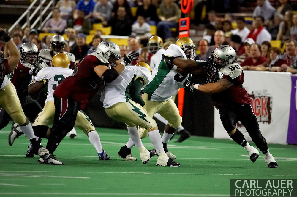 4/12/2007 - Dustin Almond (9) gets sacked by the defensive line of the Alaska Wild  in the first professional football game in Alaska.