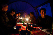 Climbing Kilimanjaro - Our group of travelers enjoys dinner inside the mess tent