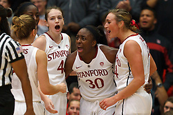 Dec 20, 2011; Stanford CA, USA;  Stanford Cardinal forward Nnemkadi Ogwumike (30) is congratulated by teammates after a basket and a foul against the Tennessee Lady Volunteers during the first half at Maples Pavilion.  Mandatory Credit: Jason O. Watson-US PRESSWIRE