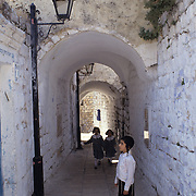 Behaving like small children everywhere in Tsfat (Safed), Israel.