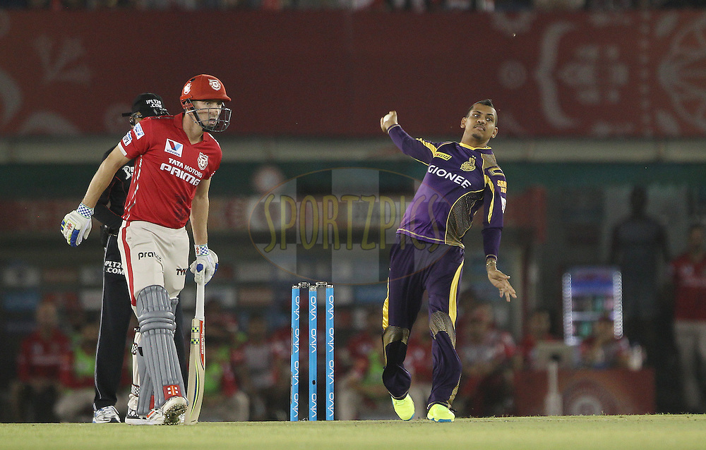 Sunil Narine of Kolkata Knight Riders sends a delivery down during match 13 of the Vivo Indian Premier League ( IPL ) 2016 between the Kings XI Punjab and the Kolkata Knight Riders held at the IS Bindra Stadium, Mohali, India on the 19th April 2016<br /> <br /> Photo by Ron Gaunt / IPL/ SPORTZPICS