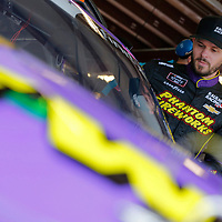 Ryan Truex (11) hangs out in the garage during practice for the US Cellular 250 at Iowa Speedway in Newton, Iowa.