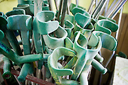 27 JUNE 2006 - SIEM REAP, CAMBODIA: Crutches at Handicap International in Siem Reap, Cambodia. Handicap International helps Cambodians maimed by mines and unexploded ordinance as well as traffic accidents and disease adjust to a life without limbs. Cambodians are still wrestling with the legacy of the war in Vietnam and subsequent civil wars. At one time it was the most heavily mined country in the world and a vast swath of Cambodia, along the Thai-Cambodian border, is still mined. In 2004, more than 800 people were killed by mines and unexploded ordinance still found in the countryside.  Photo by Jack Kurtz