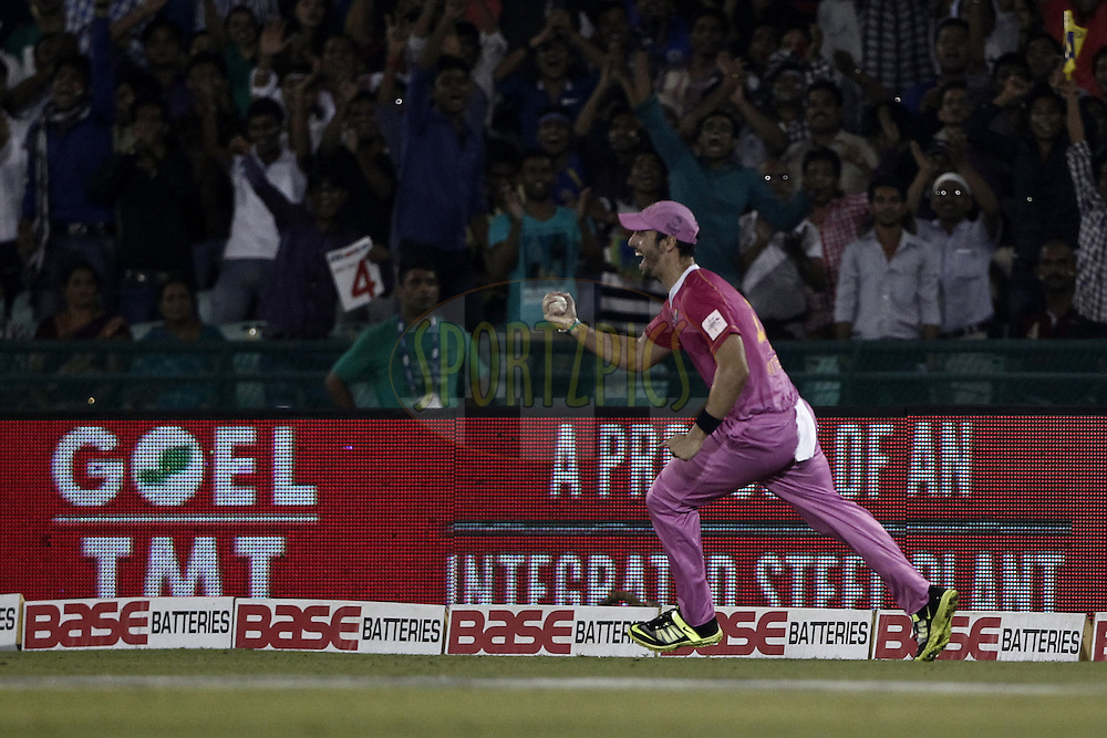 Mitchell Santner of the NORTHERN KNIGHTS take the catch of  Asif Raza of the LAHORE LIONS during the qualifier 3 match of the Oppo Champions League Twenty20 between the Northern Knights and the Lahore Lions held at the Chhattisgarh International Cricket Stadium, Raipur, India on the 14th September 2014<br /> <br /> Photo by:  Deepak Malik / Sportzpics/ CLT20<br /> <br /> <br /> Image use is subject to the terms and conditions as laid out by the BCCI/ CLT20.  The terms and conditions can be downloaded here:<br /> <br /> http://sportzpics.photoshelter.com/gallery/CLT20-Image-Terms-and-Conditions-2014/G0000IfNJn535VPU/C0000QhhKadWcjYs