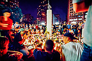 People gathering around a initially spontaneous candle light session that lasts for weeks at Union Square, honoring the killed in the WTC bombing and asking for peace...