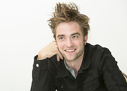 August 3, 2017 - Hollywood, California, U.S. - ROBERT PATTINSON stars in the movie Good Time.' Robert Douglas Thomas Pattinson (born May 13, 1986) is an English actor, producer, model, and musician. Pattinson started his film career by playing Cedric Diggory in Harry Potter and the Goblet of Fire. He later got the leading role of vampire Edward Cullen in the film adaptations of the Twilight novels by Stephenie Meyer, which consisted of five films between 2008 and 2012 that combined grossed over $3.3 billion in worldwide receipts. Twilight brought Pattinson worldwide fame, and established him among the highest paid and most bankable actors in Hollywood. (Credit Image: © Armando Gallo via ZUMA Studio)