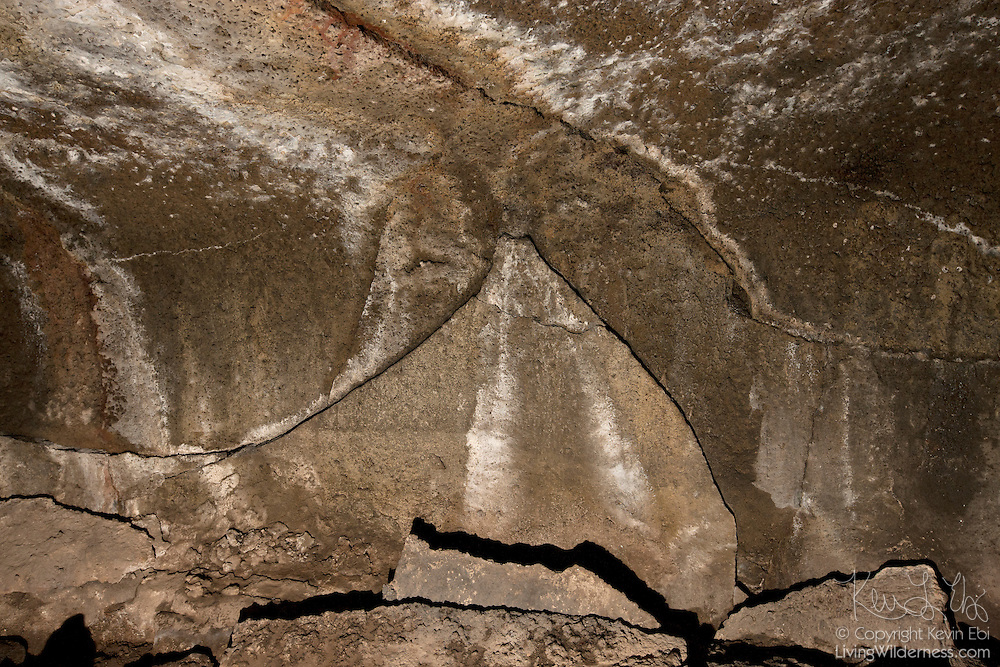 A shape resembling a volcano is visible on the wall of Subway Cave, a lava tube formed 30,000 years ago in California's Hat Creek Valley. The tube itself was formed when the top portion of the lava flow cooled to a hard crust while allowing hot lava to flow underneath. Eventually, the lava flow stopped, leaving behind the shell. This formation resulted from hot lava dripping from the ceiling of the tube.