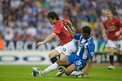 WIGAN, ENGLAND - Sunday, May 11, 2008: Manchester United's Ji-Sung Park in action against Wigan Athletic's Antonio Valencia during the final Premiership match of the season at the JJB Stadium. (Photo by David Rawcliffe/Propaganda)