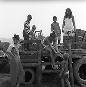 Kids hanging out on wooden truck, at Glastonbury, 1989.