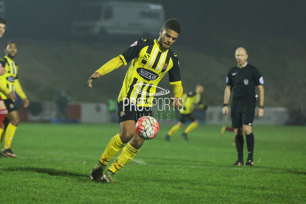 Dagenham player Joss Labadie during the The FA Cup 2nd Round Replay match between Whitehawk FC and Dagenham and Redbridge at the Enclosed Ground, Whitehawk, United Kingdom on 16 December 2015. Photo by Phil Duncan.