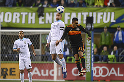 October 8, 2018 - Seattle, Washington, U.S - Seattle midfielder OZZIE ALONZO (6) heads the ball as Houston's DARWIN CEREN (24) defends on the play. Houston lost to the Seattle Sounders 4-1 in a MLS match at Century Link Field in Seattle, WA. (Credit Image: © Jeff Halstead/ZUMA Wire)