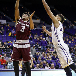 Feb 4, 2017; Baton Rouge, LA, USA; Texas A&M Aggies guard Admon Gilder (3) shoots over LSU Tigers forward Wayde Sims (44) during the second half at the Pete Maravich Assembly Center. Texas A&M defeated LSU 85-73. Mandatory Credit: Derick E. Hingle-USA TODAY Sports