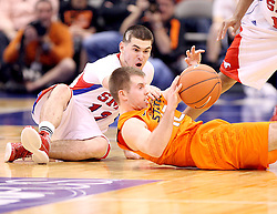 SMU guard Jeremiah Samarrippas (12) battles Oklahoma State guard Keiton Page for a loose ball during a NCAA basketball game in Dallas, Wednesday, Dec. 28, 2011. Oklahoma St won 68-58.