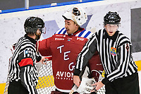 2019-12-30 | Umeå, Sweden:The Referees have a chat with Teg (1) Arvid Stenmark and take care of the puck in AllEttan during the game  between Teg and Hudiksvall at A3 Arena ( Photo by: Michael Lundström | Swe Press Photo )<br /> <br /> Keywords: Umeå, Hockey, AllEttan, A3 Arena, Teg, Hudiksvall, mlth191230