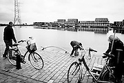 A local family of Ijburg go fishing off the pier in their local neighbouhood. Image © Angelos Giotopoulos/Falcon Photo Agency.