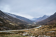 A stunning viewpoint on the A832 to Gairloch, in Glen Docherty, Scotland showing the winding road down to Kinlochewe and the tip of Loch Maree.