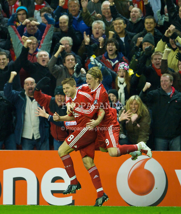 LIVERPOOL, ENGLAND - Tuesday, March 10, 2009: Liverpool's captain Steven Gerrard MBE celebrates scoring the third goal, his second, against Real Madrid with team-mate Fernando Torres during the UEFA Champions League First Knockout Round 2nd Leg match at Anfield. (Photo by David Rawcliffe/Propaganda)