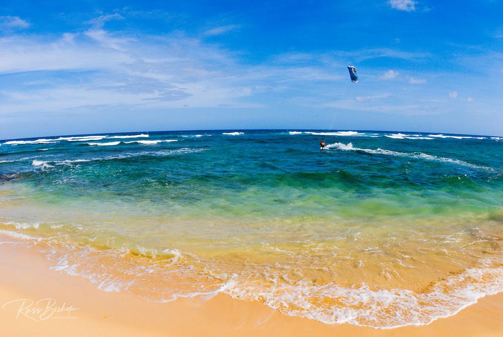Kite surfer off Gillin's Beach at Maha'ulepu on the south shore, Island of Kauai, Hawaii