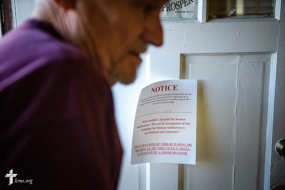 A notice prohibiting human habitation due to flood damage is seen posted on the door of Nanny's Korner Care Center, on Thursday, Jan. 19, 2017, in Lumberton, N.C. The center was damaged in October from flooding related to Hurricane Matthew. LCMS Communications/Erik M. Lunsford