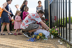© Licensed to London News Pictures. 16/06/2017. LONDON, UK.  Fiends lay flowers for Jo Cox. Neighbours and friends of Jo Cox attend The Great Get Together near Hermitage Moorings in Wapping to pay tribute and celebrate Jo's call that more unites us than divides us on the anniversary of her death. Jo Cox lived on a house boat in Wapping with her husband Brendan Cox and two children. Photo credit: Vickie Flores/LNP