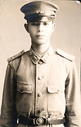 portrait young adult boy in uniform Japan ca 1940s