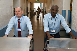 Logistic Operatives wheeling food trolleys down the Hospital corridor to various wards and departments,