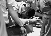 luogo : Napoli  - data : 12 luglio 1995 - titolo : disperazione degli arrestati<br /> ( Servizio inerente i fatti criminosi avvenuti in Campania e a Napoli nell'ultimo decennio )<br /> copyright Stefano Renna fotografia.<br /> <br /> VAI ALLE FOTO IN ARCHIVIO<br /> http://stefanorenna.photoshelter.com/gallery/03-MANETTE/G0000KWxrZcFd4XQ/C0000ujr_mqfrFyY
