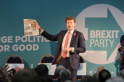© Licensed to London News Pictures. 04/11/2019. London, UK. Brexit Party Chairman RICHARD TICE MEP holds a copy of The Evening Standard with the headlines 'FARAGE PUSHES THE TORY CAMPAIGN OFF TRACK' at an event in The Emmanuel Centre, Westminster where the party's Prospective Parliamentary Candidates (PPC) for the 2019 general election to be held on 12 December 2019 are  introduced.  Photo credit: Dinendra Haria/LNP