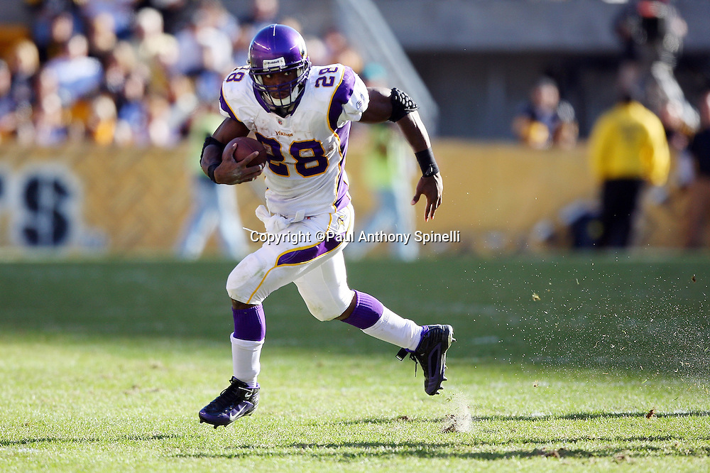 Minnesota Vikings running back Adrian Peterson (28) runs the ball for a key fourth quarter first down during the NFL football game against the Pittsburgh Steelers, October 25, 2009 in Pittsburgh, Pennsylvania. The Steelers won the game 27-17. (©Paul Anthony Spinelli)