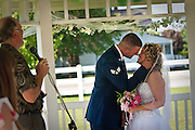 Josh and Stephanie MacKay share their first kiss as married husband and wife under the gazebo outside Four Seasons Memory Care in Coeur d'Alene on Thursday afternoon.